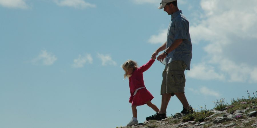 father daughter walking down a hill